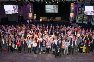Large group of Healthwatch staff and volunteers standing together