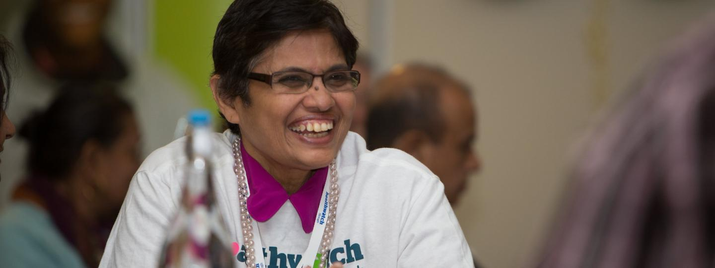 Woman smiling during healthwatch event